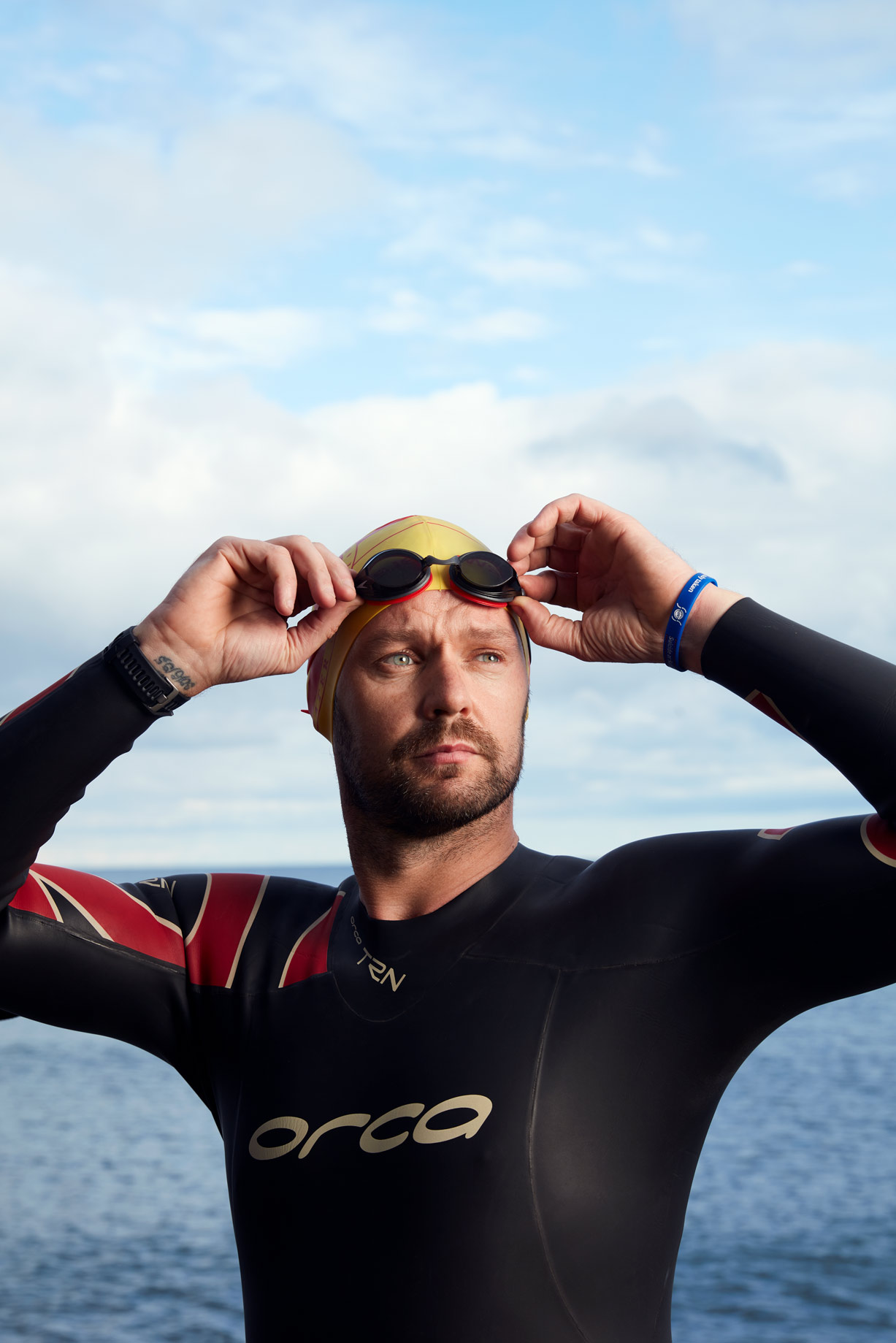 business photography_: John Blake triathlete prepares to swim