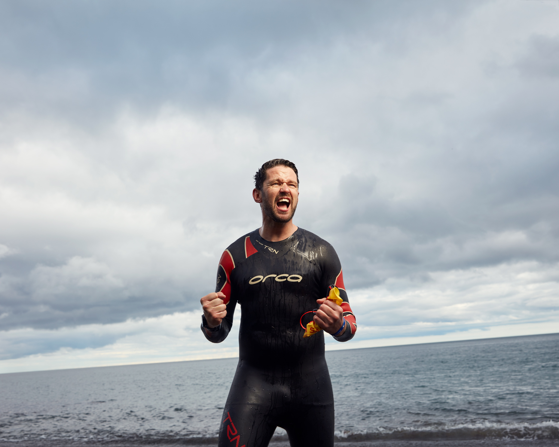 athlete portraits: focused triathlete in wetsuit