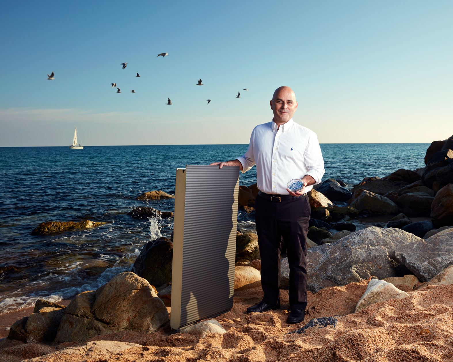 man stands on beach beside sea with insulating panel