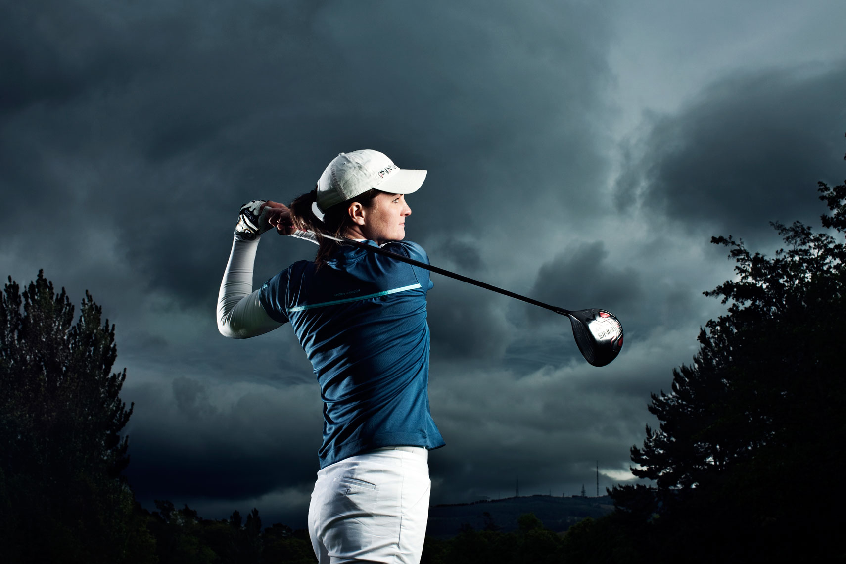 dramatic portrait of golfer mid swing