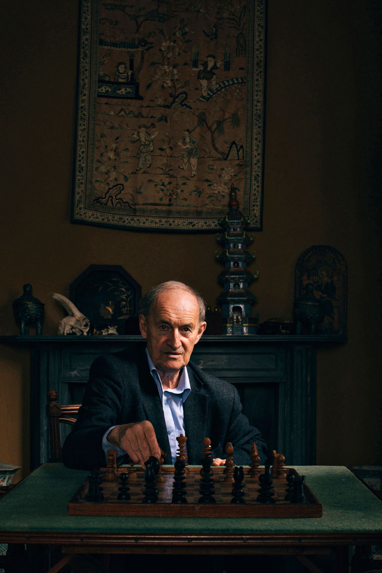 elderly man plays chess