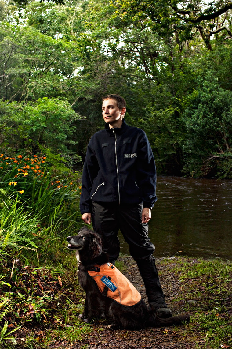 coast guard dog and trainer in forest