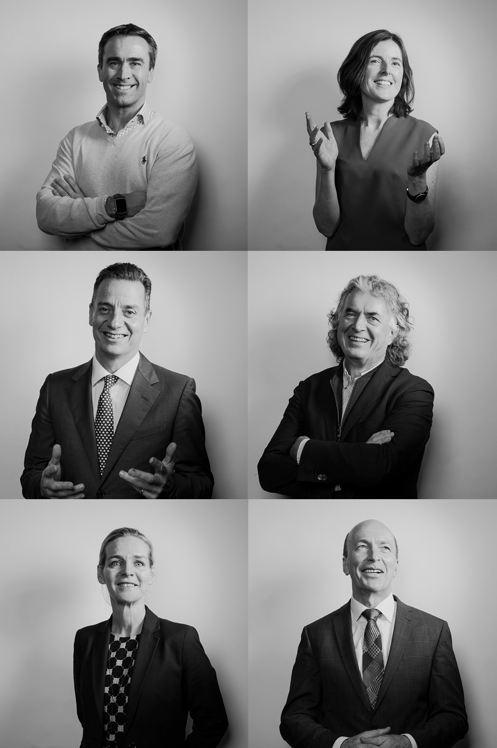 black and white happy board of director portraits against a white backdrop
