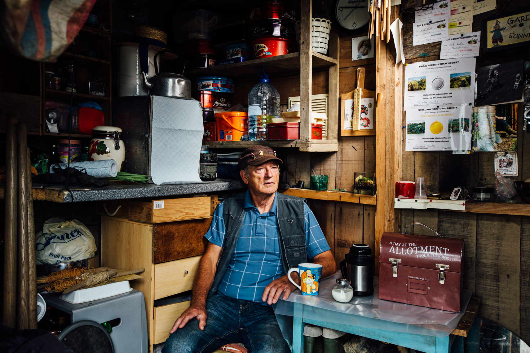 environmental photography: a gardener relaxes in  his shed