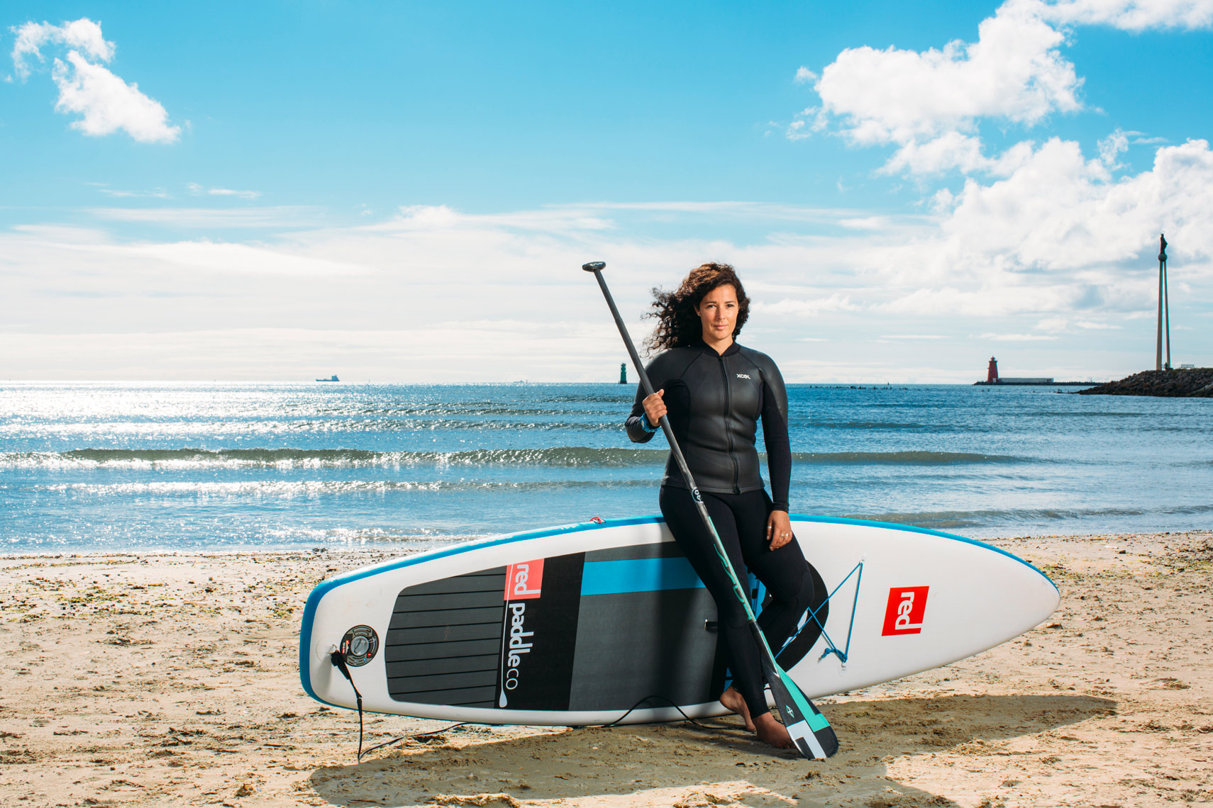 athlete portraits: a paddleboarder on beach