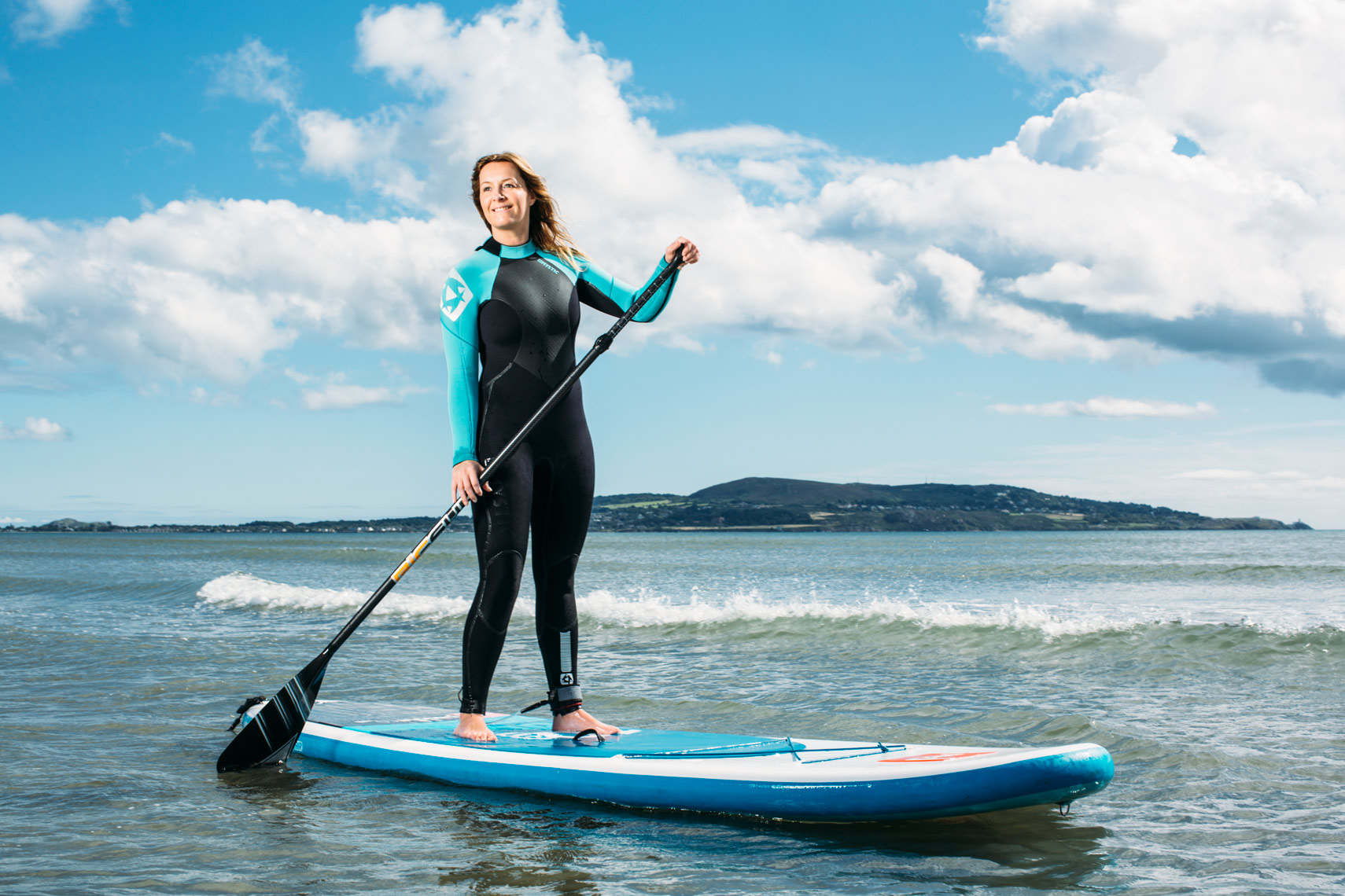 athlete portraits: paddleboarder paddles on sea