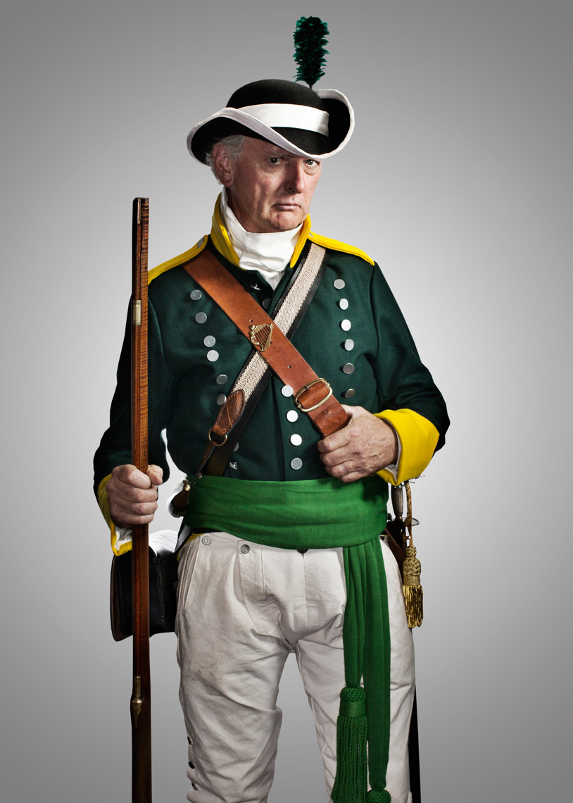 irish battle reenactor with hat and feather