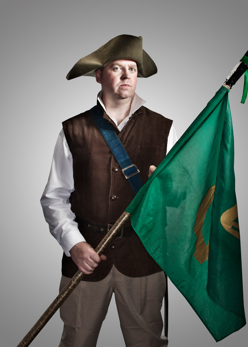 battle reenactor with green flags