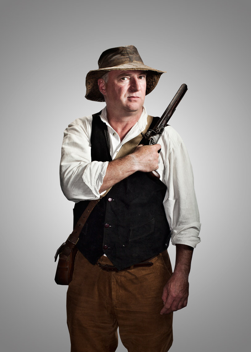 battle reenactor with handgun on shoulder