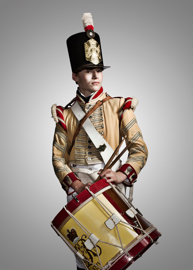 young boy battle reenactor with drums