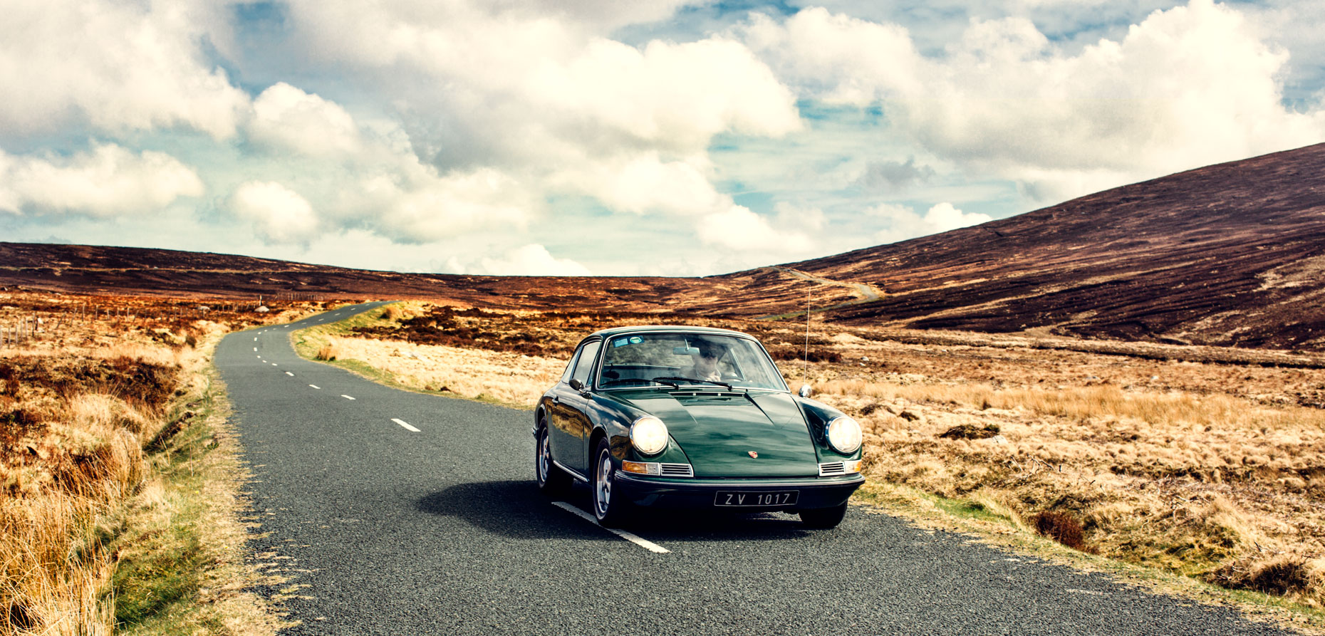 portrait photography: a vintage porsche on the open road